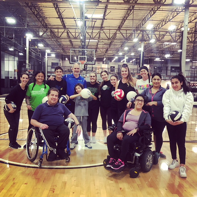 Athletes Volunteer to Coach Disabled Volleyball Players